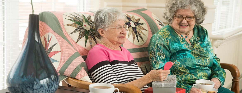 Residents visit over tea.