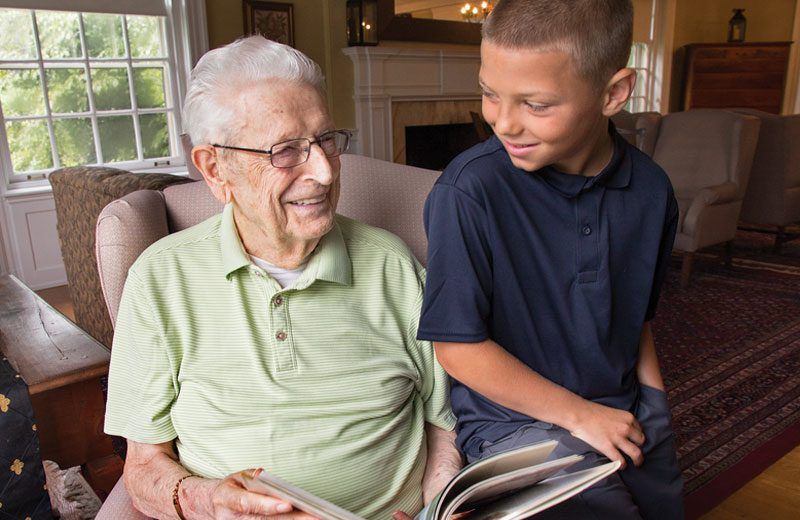 Image of a child with a senior resident at The Hickman