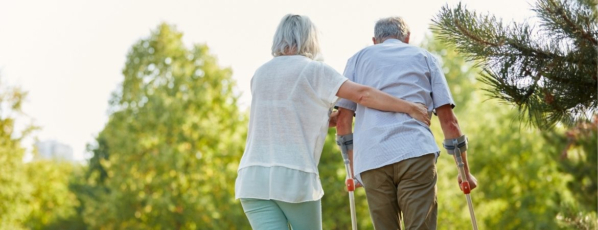 Fall prevention for the elderly while a woman assists a man.