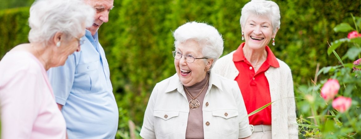 Residents of The Hickman smiling enjoying the weather together at the Hickman.